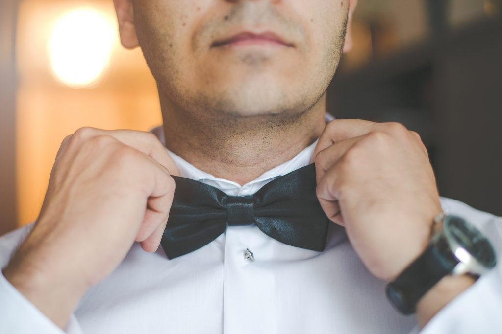 groom-fixing-bow-tie